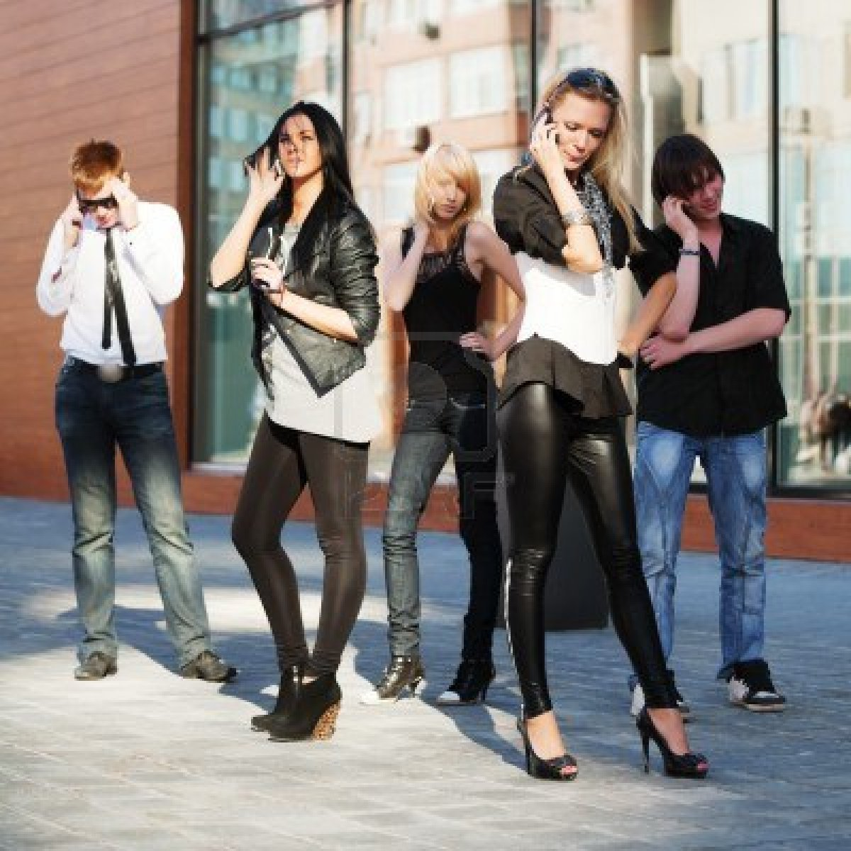 9963112-young-people-calling-on-the-mobile-phones