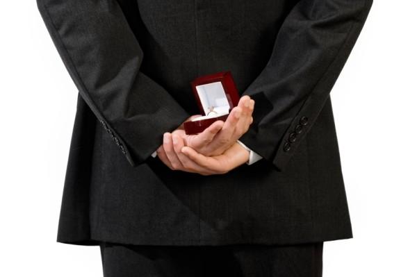 man-holding-engagement-ring
