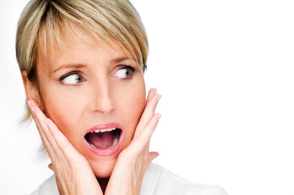 young blond woman surprised expression close up shoot