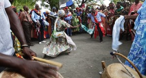 Haitians dance under a sacred ceibo tree called Lisa as they participate in a Voodoo ritual in Souvenance