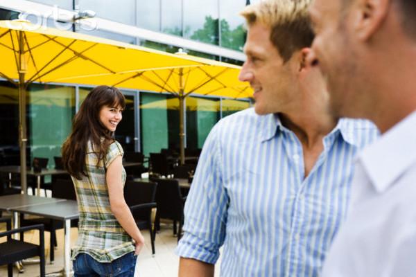 Men flirting with woman on street